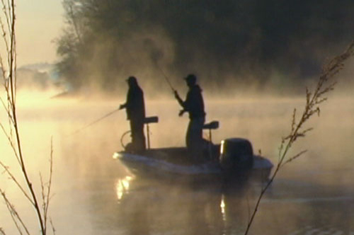 Men fishing with fog